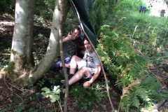 Young people building shelters in Bush Craft